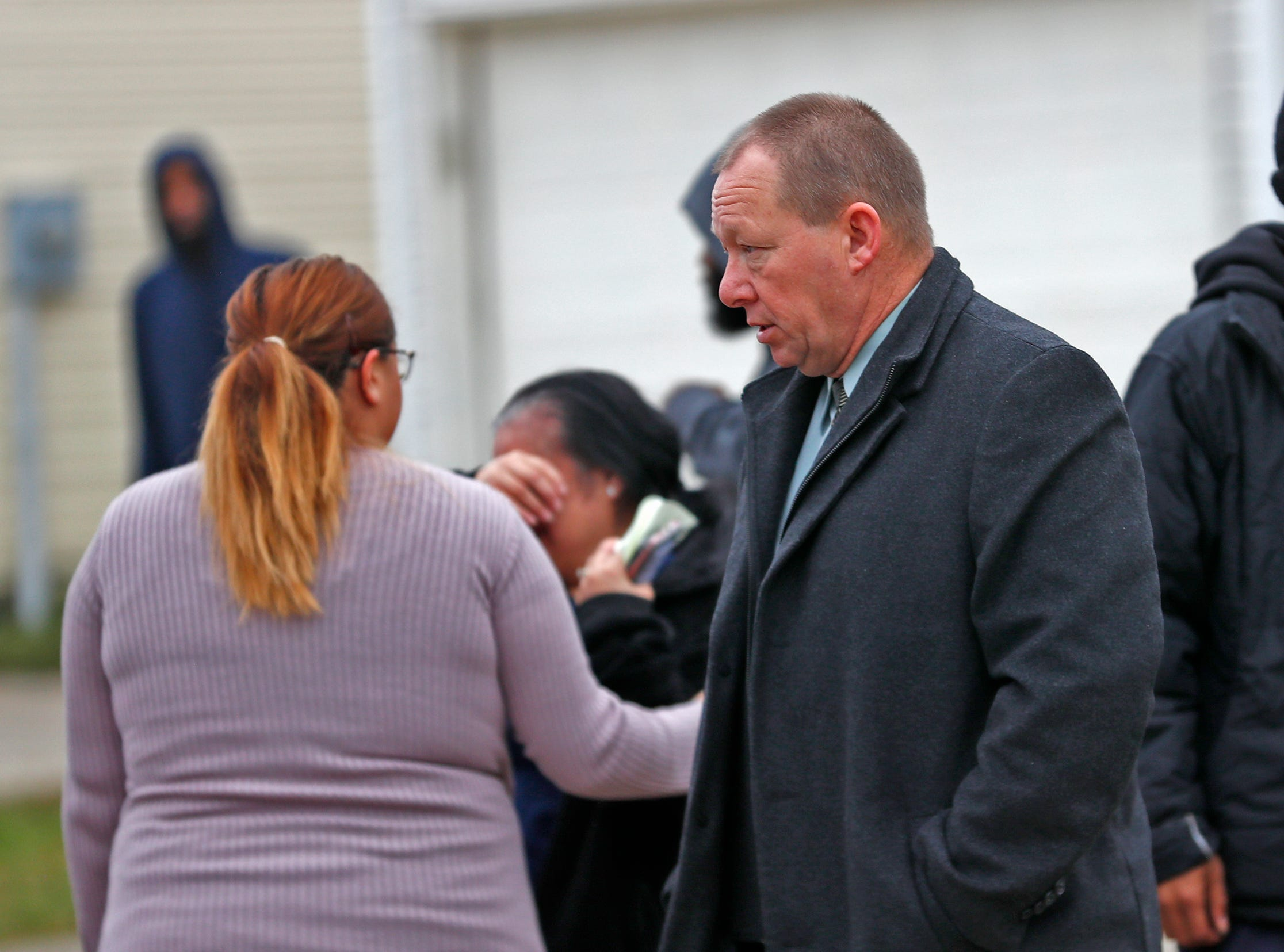 A detective speaks to family at the scene of a homicide in the 3800 block of Amaranth Court, Friday, Nov. 30, 2018.