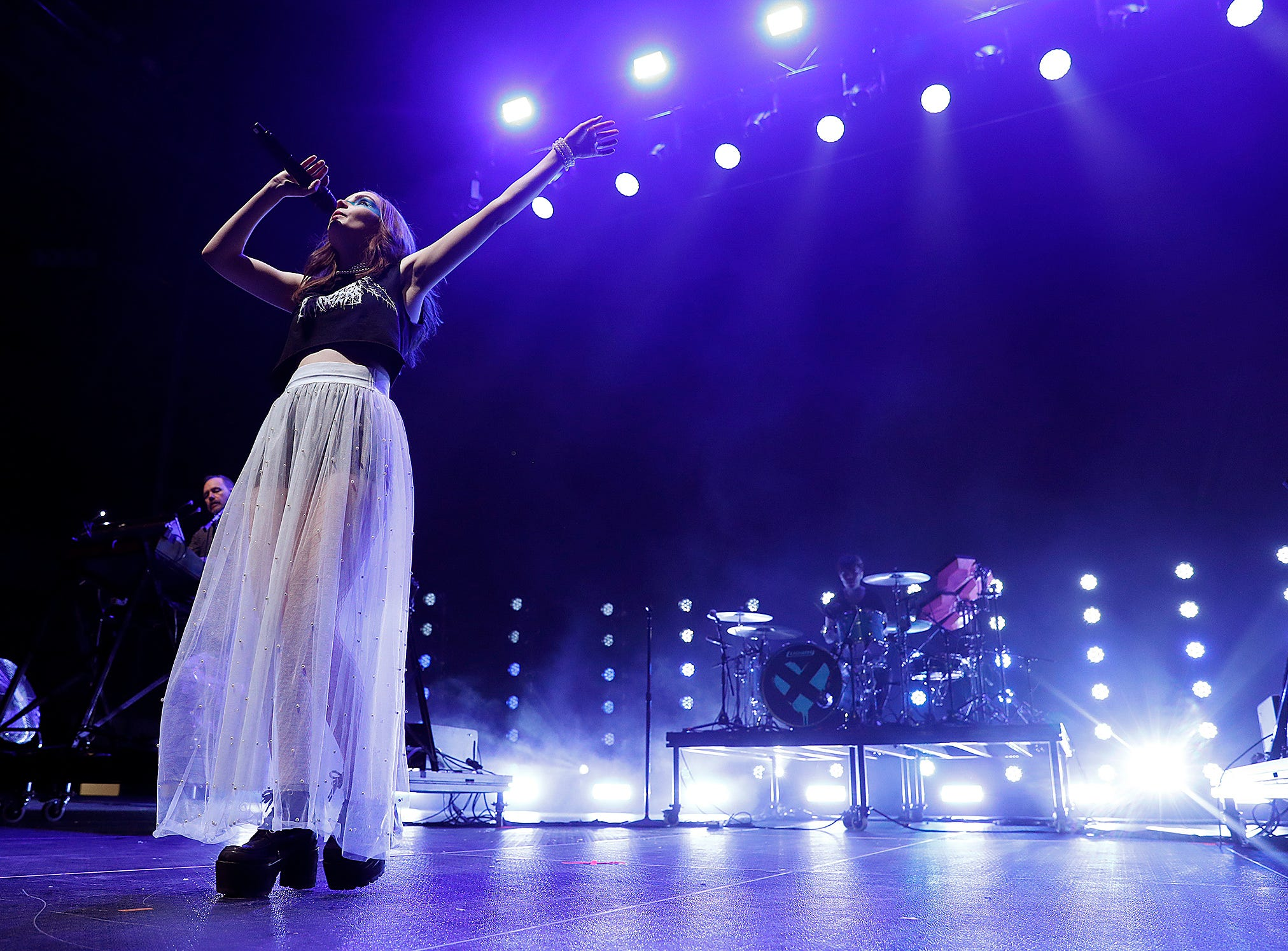 """The group Chvrches performs during the """"The Night ALT 103-3 Stole Xmas"""" concert at Indiana Farmers Coliseum on Thursday, Nov. 29, 2018."""