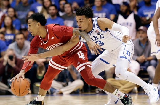 Duke's Tre Jones (3) reaches in on Indiana's Devonte Green during the second half of an NCAA college basketball game in Durham, N.C., Tuesday, Nov. 27, 2018.