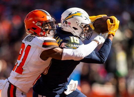 Oct 14, 2018; Cleveland, OH, USA; Los Angeles Chargers wide receiver Tyrell Williams (16) makes a touchdown reception as Cleveland Browns cornerback Denzel Ward (21) tackles him during the second quarter at FirstEnergy Stadium.