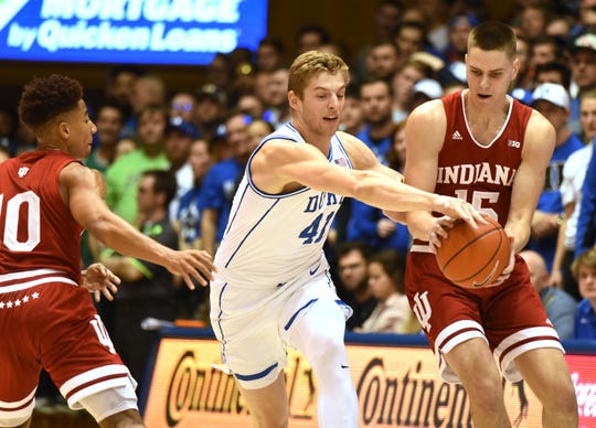 Duke Blue Devils forward Jack White (41) attempts to steal the ball in front of Indiana Hoosiers forward Evan Fitzner (55) during the first half at Cameron Indoor Stadium.