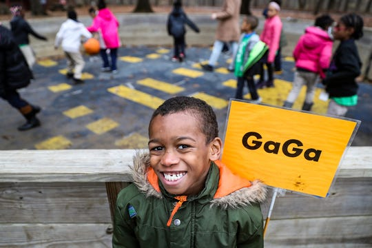 Bre'Shaun Hutcherson, a second grader from Global Preparatory Academy, poses for a picture while playing a game of Gaga at Jameson Camp in Indianapolis, Friday, Nov. 30, 2018. Field trip outings and summer camps aim to build children's confidence and interpersonal skills while immersing them in nature. Summer camp tuition ranges from $80 to $500 and is based on a family's income.