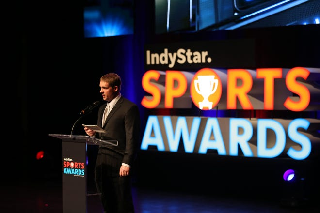 IndyStar preps reporter Kyle Neddenriep presents an award during the third annual IndyStar Sports Awards held at Butler's Clowes Memorial Hall on Sunday, April 29, 2018.
