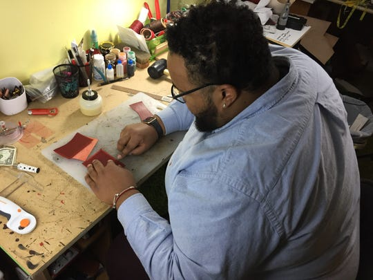 Tracy James, working in his art studio in his Butler-Tarkington home on Tuesday, Nov. 27, 2018, attributes his professional success to his time at Jameson Camp.