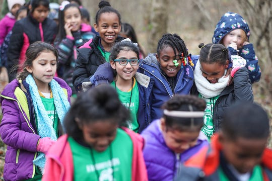 Students are led on a hike by a counselor during a field trip to Jameson Camp in Indianapolis.