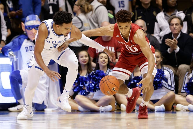 Duke's Tre Jones (3) and Indiana's Rob Phinisee (10) chase the ball during the first half of an NCAA college basketball game in Durham, N.C., Tuesday, Nov. 27, 2018.