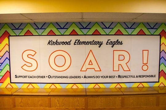 """A mural in the front hallway reads, """"SOAR!"""" on Friday, Nov. 30, 2018, at Kirkwood Elementary in Coralville. It continues, """"Support each other, Outstanding leaders, Always do your best, Respectful & Responsible."""""""