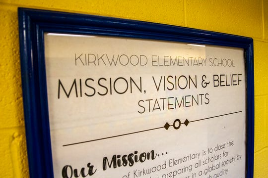 A framed poster lists mission, vision and belief statements on Friday, Nov. 30, 2018, at Kirkwood Elementary in Coralville.