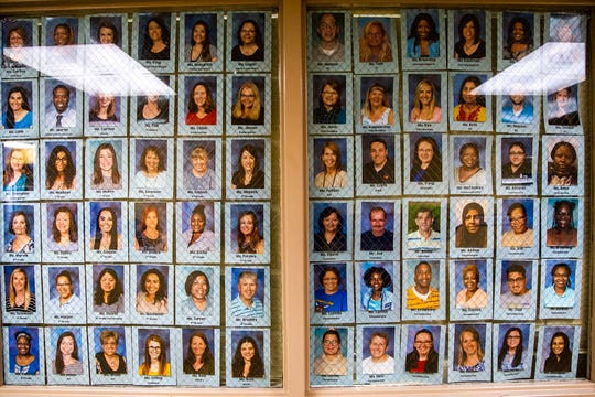 Teacher and staff photos hang in a front hallway on Friday, Nov. 30, 2018, at Kirkwood Elementary in Coralville.