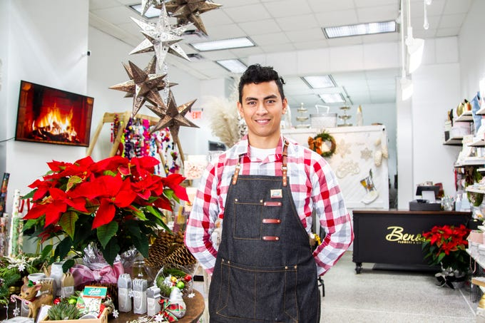 Benito Ocampo stands for a photo on Friday, Nov. 30, 2018, at Beno's Flowers on Iowa Avenue in Iowa City.