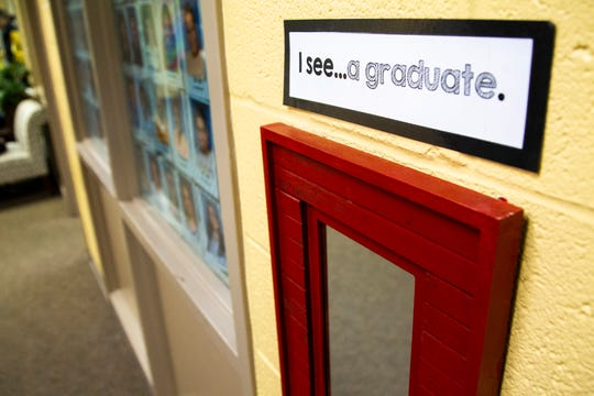 """A sign above a mirror reads, """"I see... a graduate."""" on Friday, Nov. 30, 2018, at Kirkwood Elementary in Coralville."""