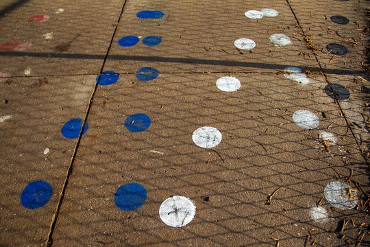 Painted dots are scattered on a sidewalk leading towards the main entrance on Friday, Nov. 30, 2018, at Kirkwood Elementary in Coralville.