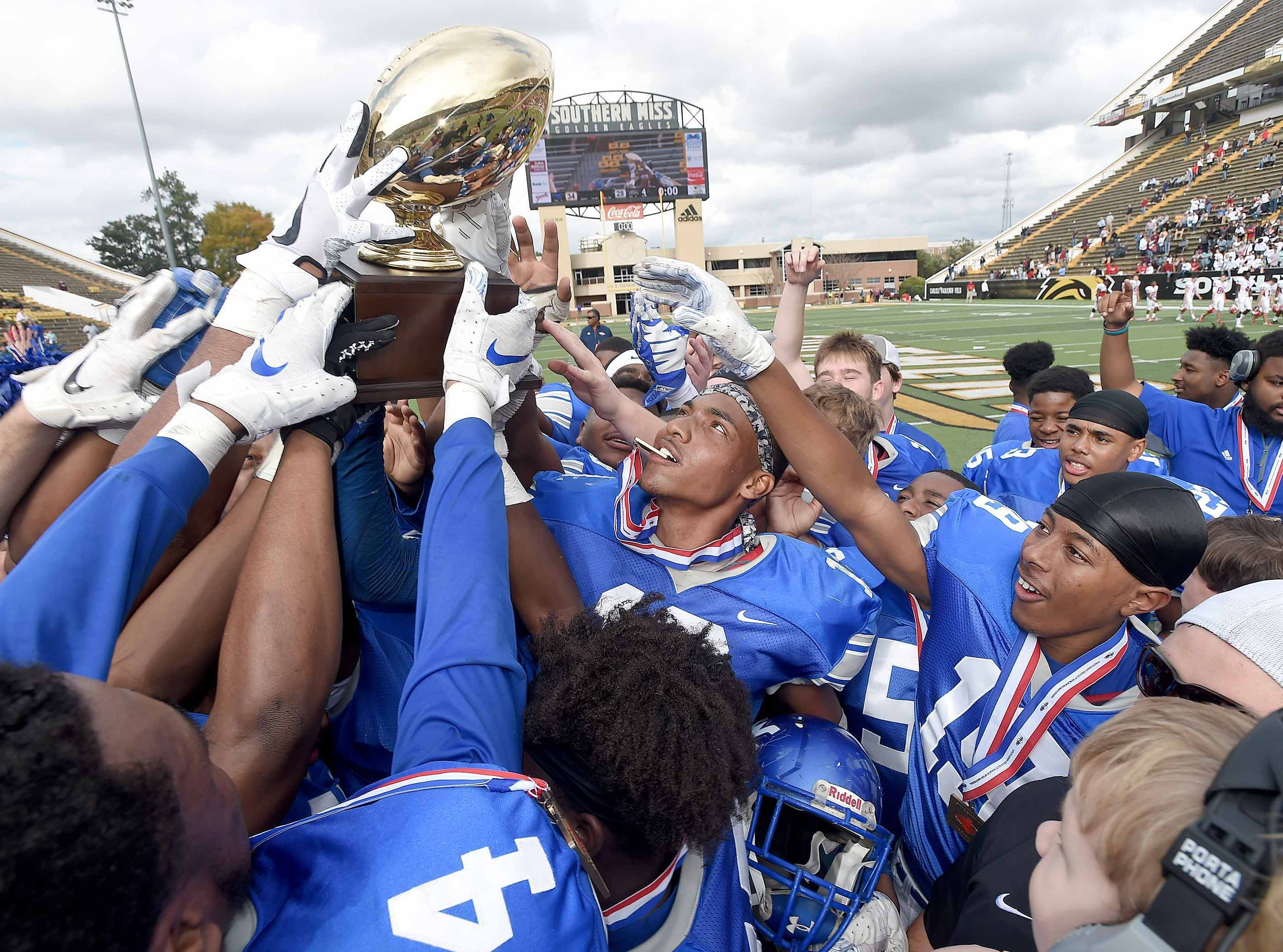 The Water Valley Blue Devils celebrate with the trophy on Friday, November 20, 2018, in the MHSAA BlueCross BlueShield Gridiron Classic High School Football Championships in M.M. Roberts Stadium on the University of Southern Mississippi campus in Hattiesburg, Miss.