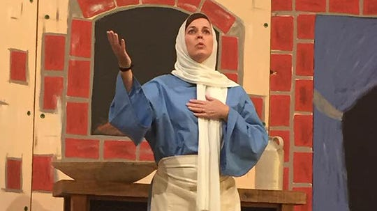 "An actress performs in the Christmas cantata ""Follow the Star: A  Journey to the Manger."""