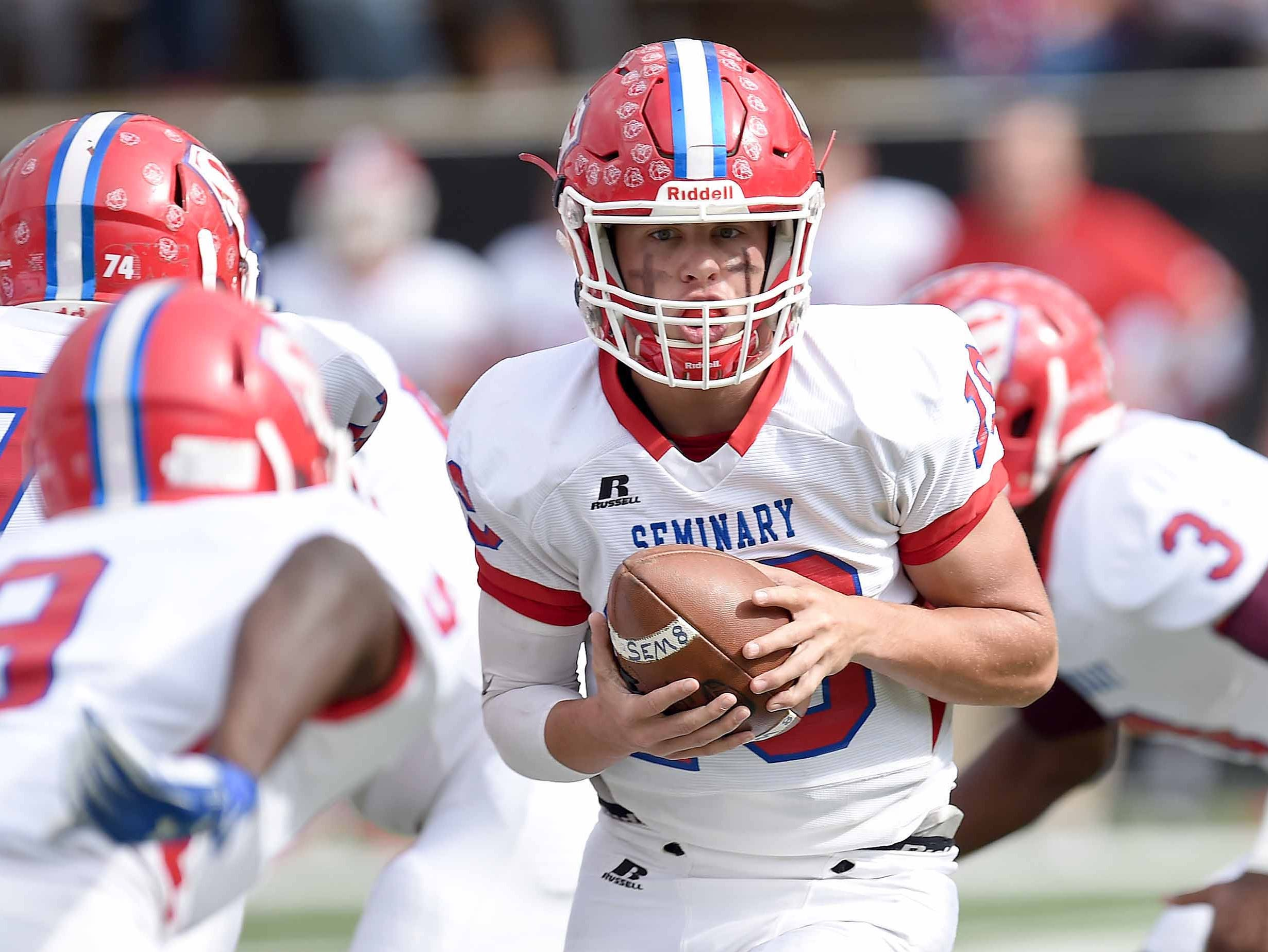Seminary quarterback Jeff Miller (19) prepares to hand the ball off against Water Valley on Friday, November 20, 2018, in the MHSAA BlueCross BlueShield Gridiron Classic High School Football Championships in M.M. Roberts Stadium on the University of Southern Mississippi campus in Hattiesburg, Miss.