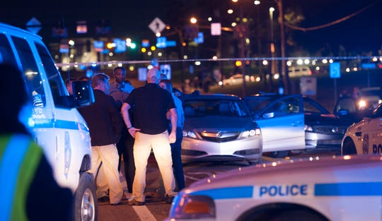 A drive-by shooting in Jackson, Mississippi, is investigated by law enforcement.