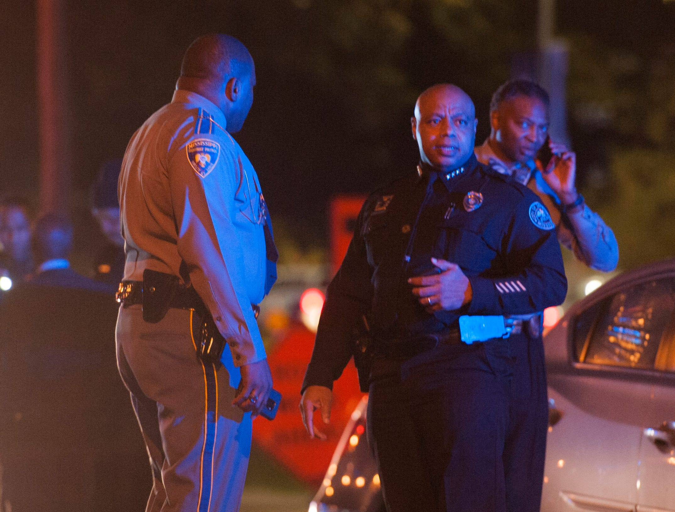 Jackson Police Chief James Davis, right, talks with a member of the Mississippi Highway Safety Patrol assisting in the investigation of a shooting on North State Street in front of UMMC.