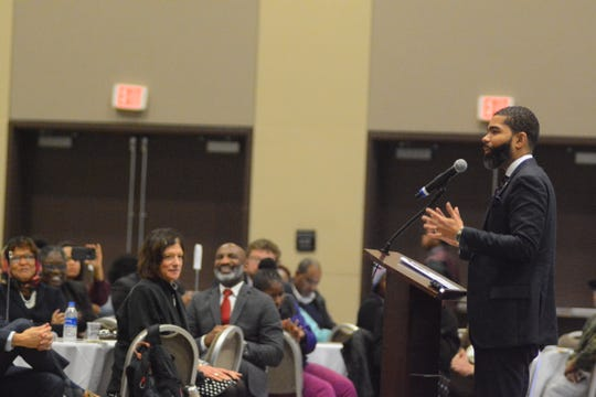 Jackson Mayor Chokwe Antar Lumumba explains at a Better Together Commission event on Nov. 29, 2018, how his favorite Jackson Public Schools teacher got him to act as the attorney for Hans and Gretel in the famous children's story in order to get Lumumba interested in class.