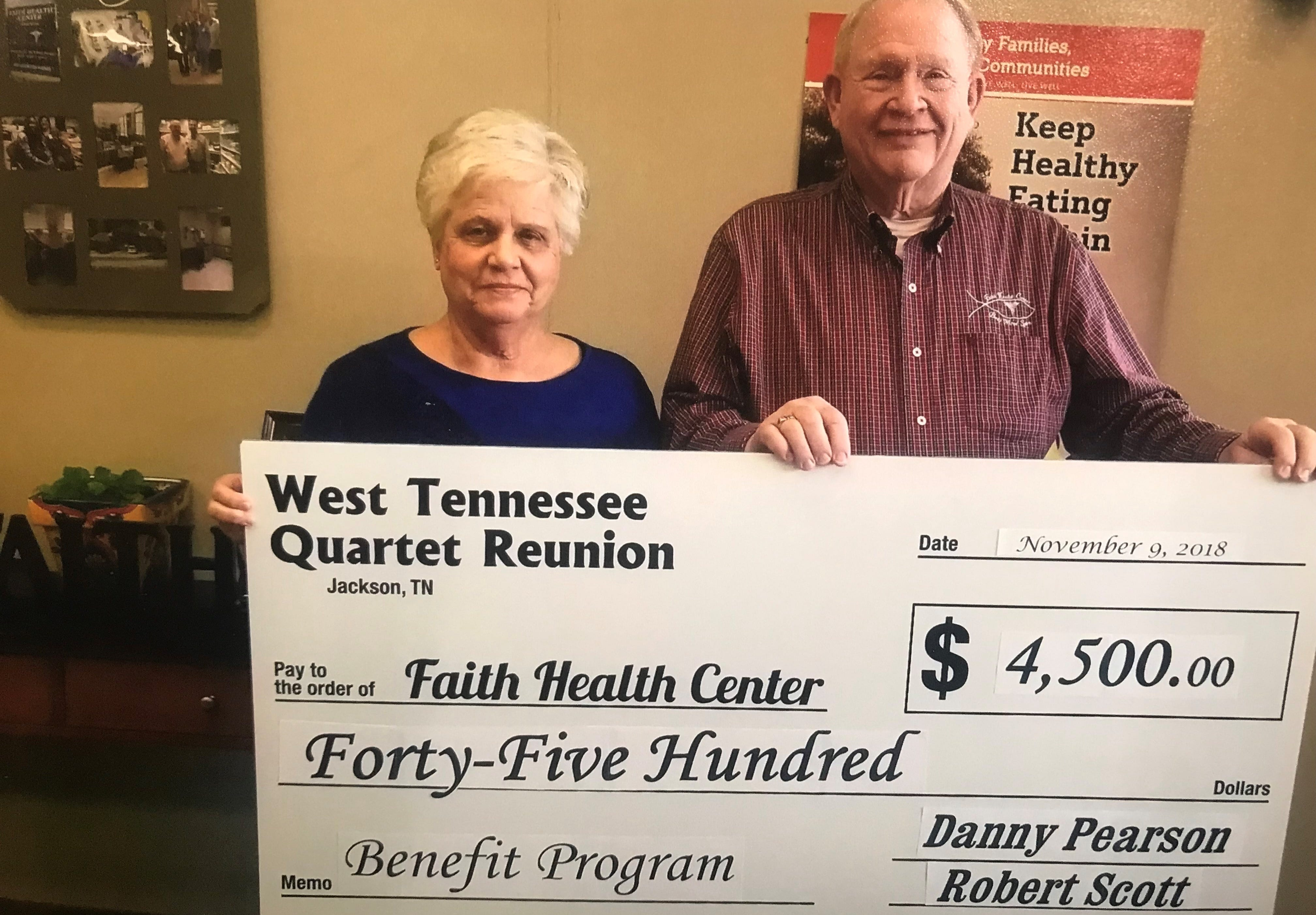 Dr. David Larsen, and his wife Sara, accept a check for $4,500 from the West Tennessee Quartet Reunion.
