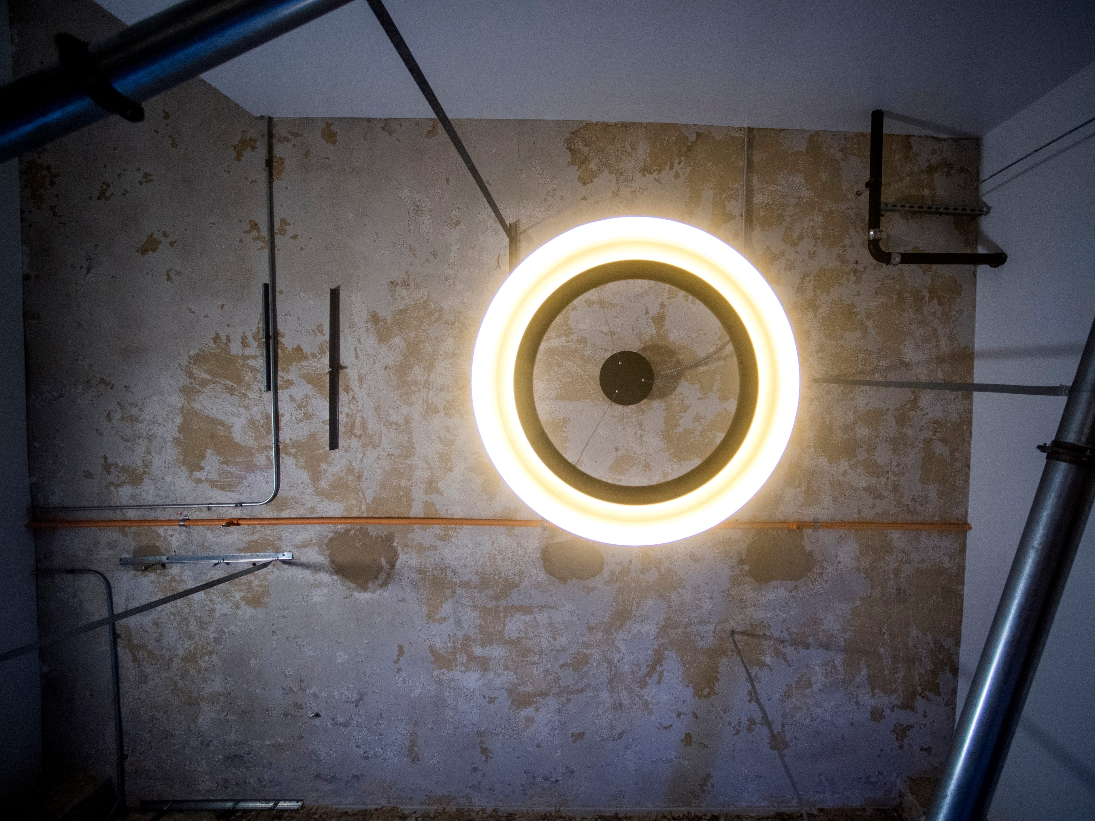 A light fixture hangs from the ceiling in a condo being renovated at Sterchi Lofts on Gay St. in downtown Knoxville. New light fixtures are being put in the renovated condos.