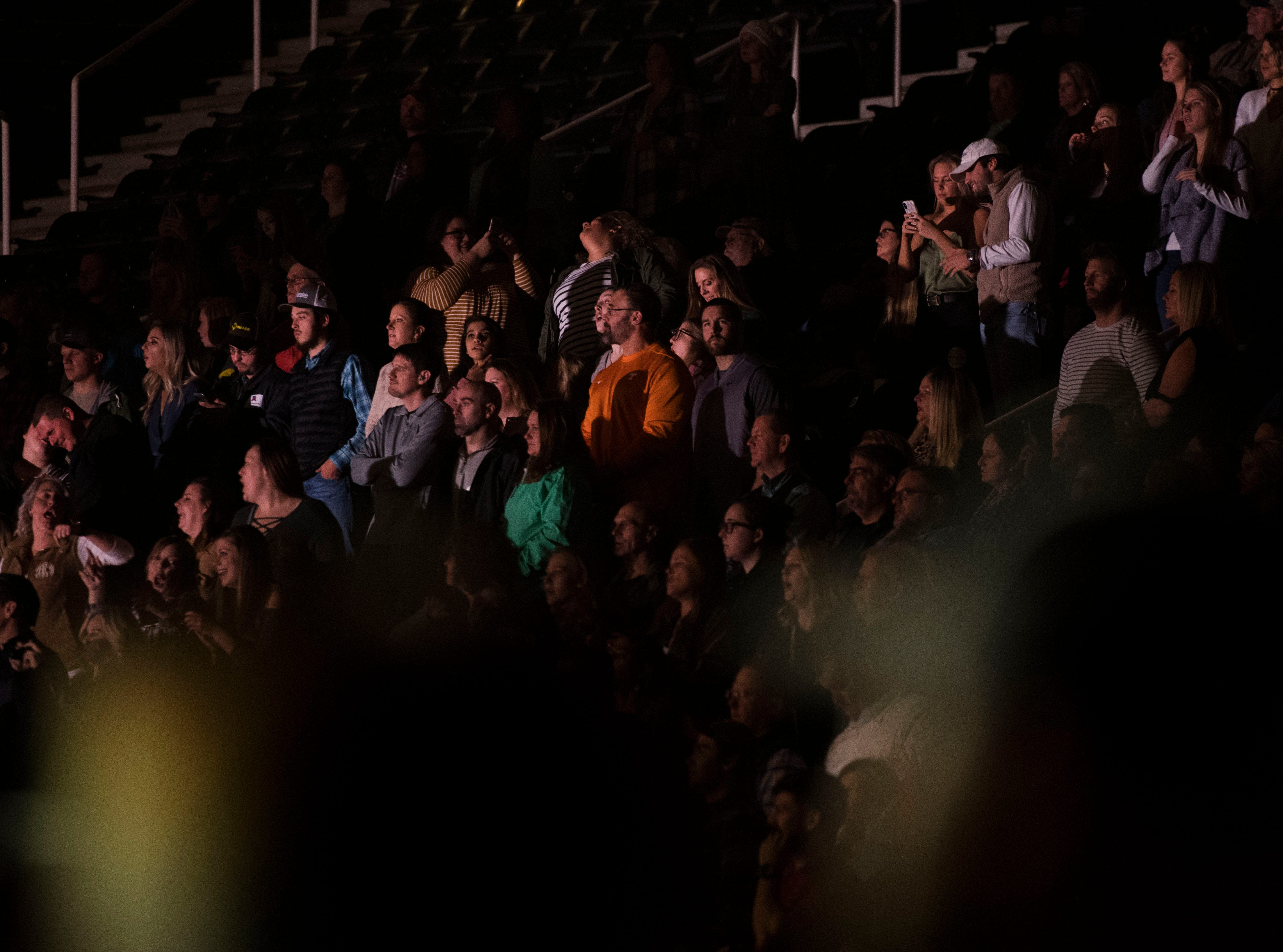 Fans listen during a Chris Young concert at Thompson-Boling Arena featuring openers Morgan Evans and Dan + Shay Thursday Nov. 29, 2018.