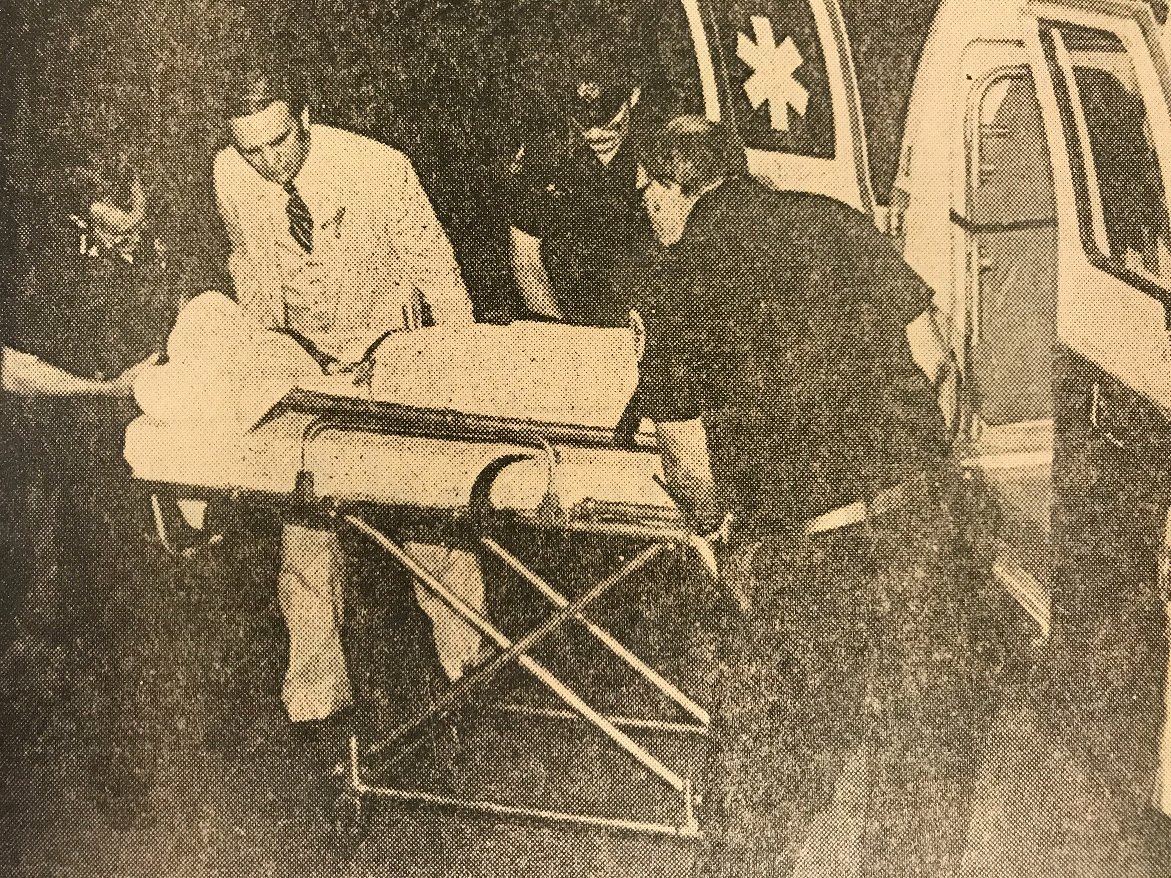 Lee Standifer's body is moved into an ambulance after her murder in this News Sentinel archive photo.