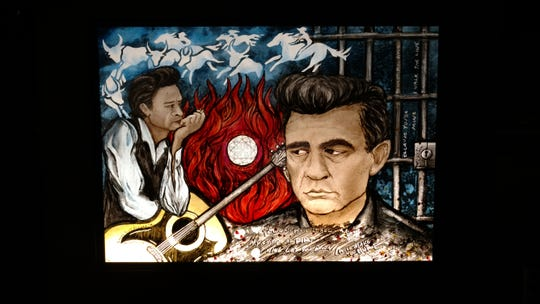 Stained glass artist Laura Goff enjoys paying homage to pop culture icons like David Bowie and Johnny Cash with her light boxes.