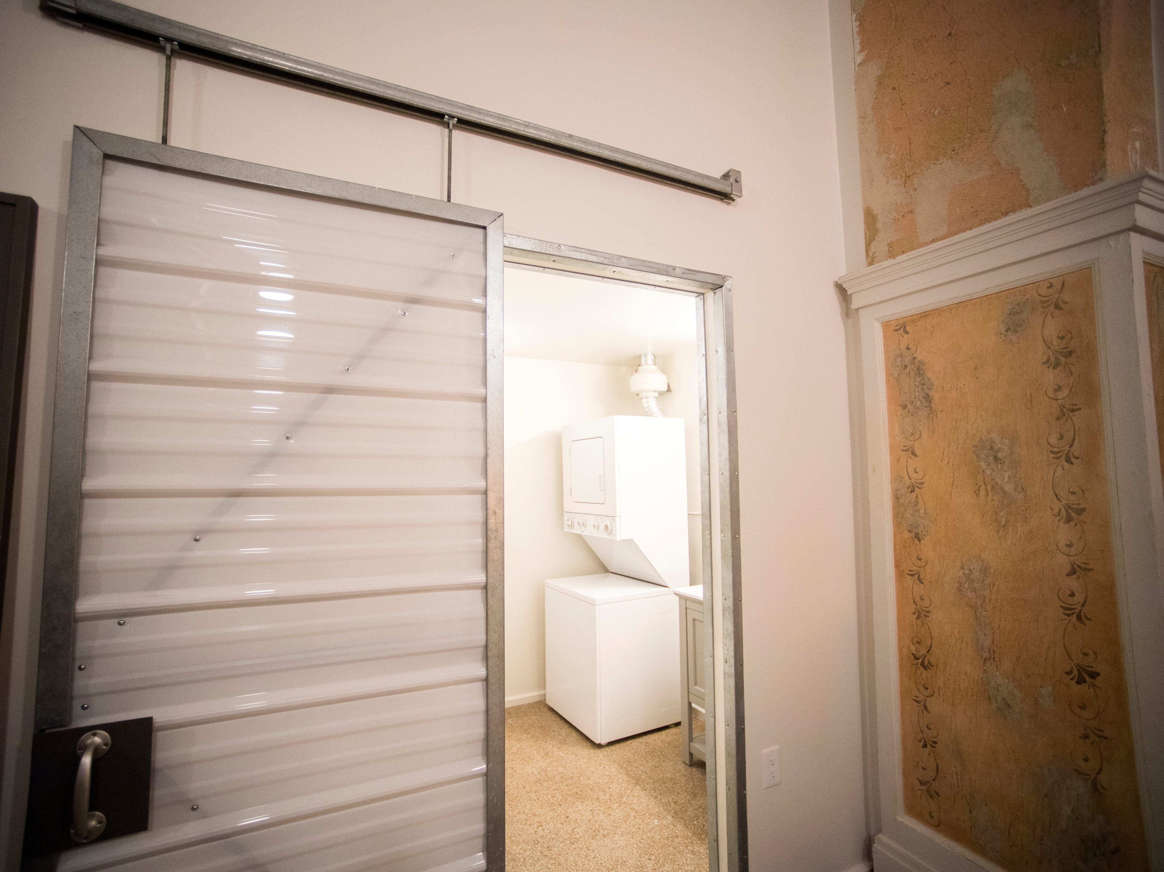 A sliding door to the bathroom in a renovated condo at Sterchi Lofts on Gay St. in downtown Knoxville.