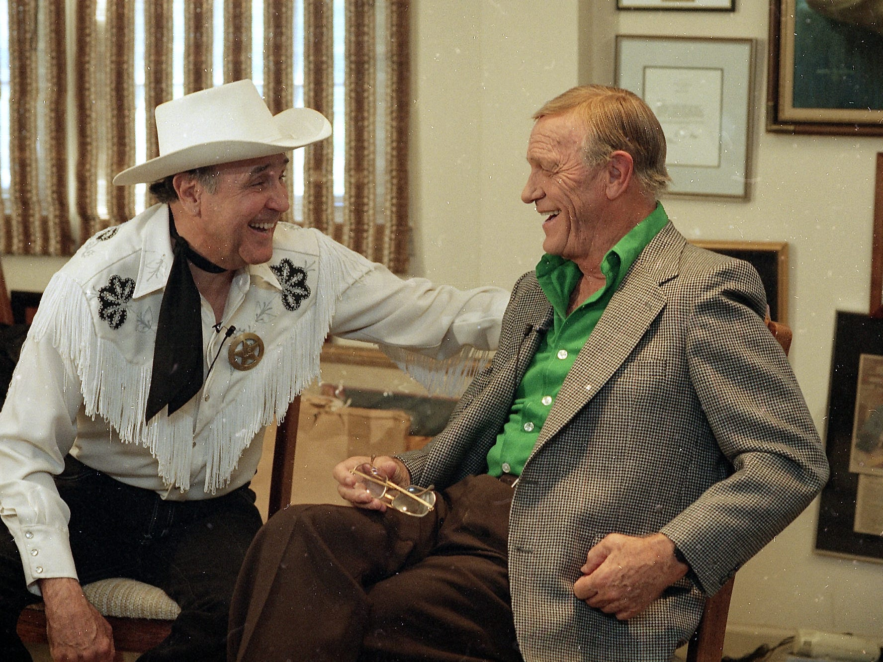 "Andy Small (left) and Eddy Arnold share a laugh in Arnold's Brentwood, TN office in this 1994 photograph. Arnold, whose mellow baritone on songs like ""Make the World Go Away"" made him one of the most successful singers in history, died Thursday 050808 at a care facility just south of Nashville. He was 89."
