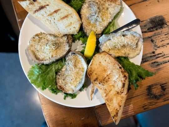 Chesapeake's serves grilled oysters.
