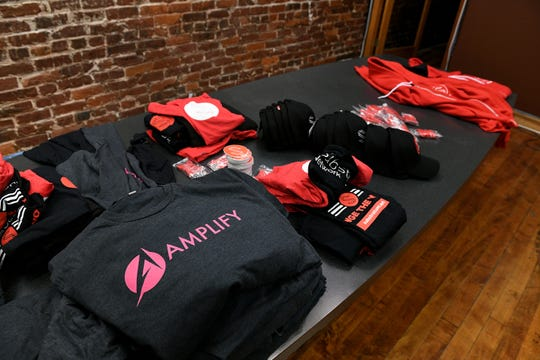 Branded promotional materials for Amplify are at the new office space on Market Square. Amplify is a tech company involved with cryptocurrency.