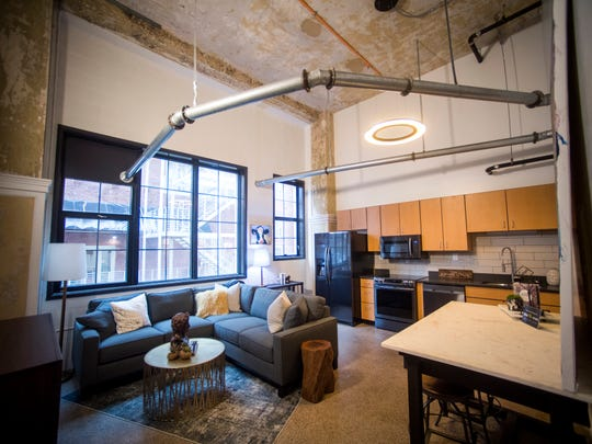 The Living Room And Kitchen Area In A Condo Being Renovated At Sterchi Lofts On