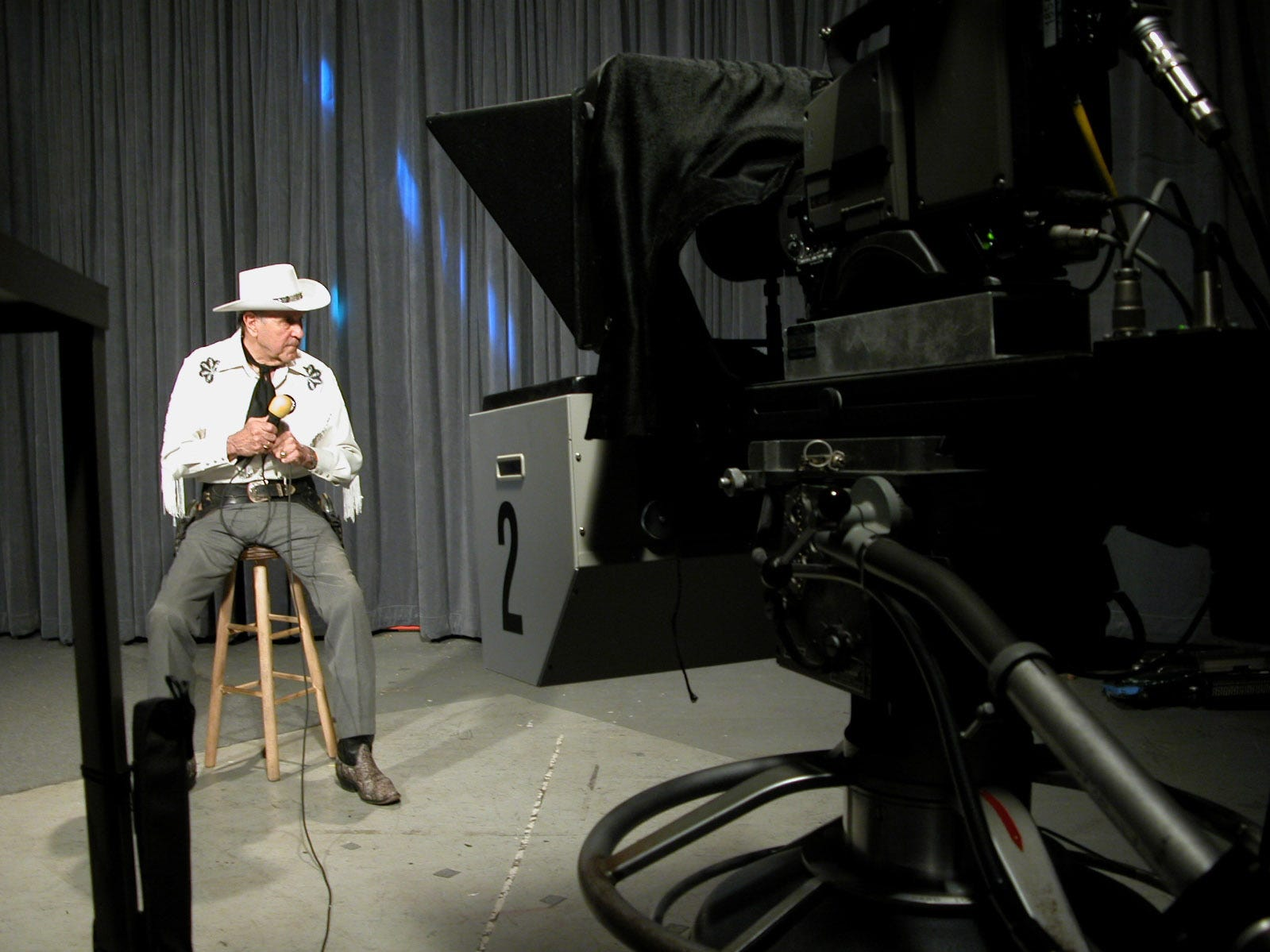 July 14, 2004) Marshal Andy listens to the producer between takes on the set of his PBS show, Riders of the Silver Screen. Andy has been hosting the program, on several stations, for 21 years and has broadcast over 1,200 shows. It is now filmed in the East Tennessee Public Television studios in East Knoxville.