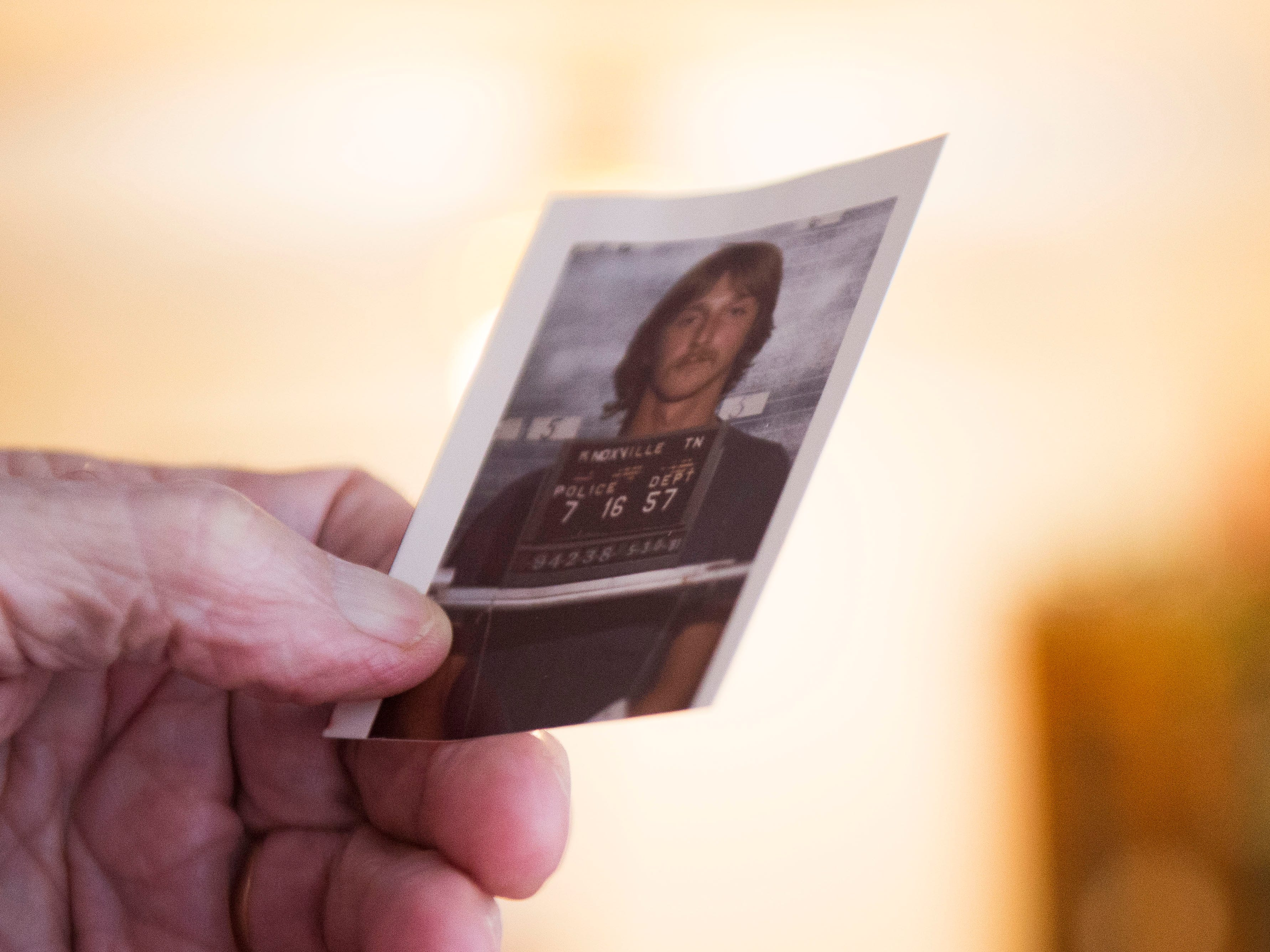 Retired Knoxville Police Department investigator Jim Winston, holds a mugshot of David Earl Miller in his Knoxville home Tuesday, Nov. 27, 2018. Winston recounted the case of David Earl Miller's murder of Lee Standifer back in the 1980's.