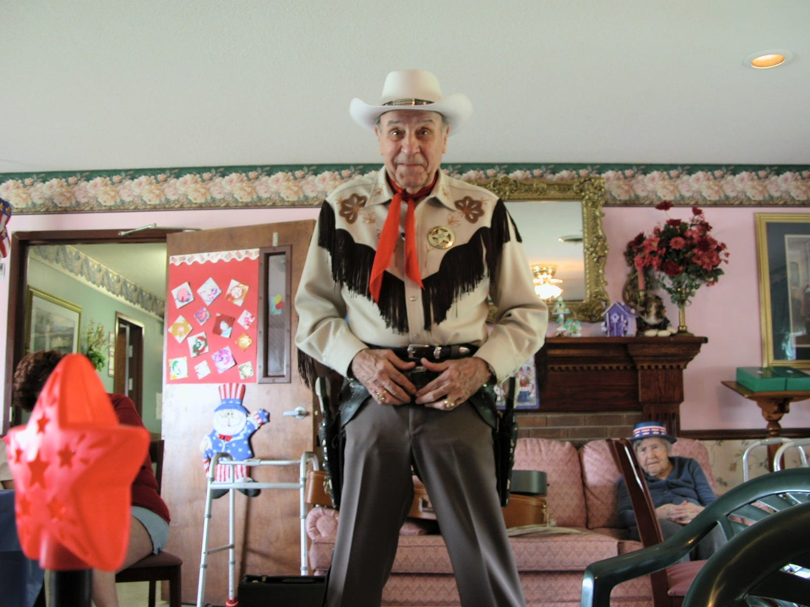 Marshal Andy sings cowboy songs of the 30s and 40s in the living room of the Home Away from Home care center in Maryville. Though he is as old as many of the residents and is suffering from a painful illness, he says the thrill of performing keeps him going strong and blunts the pain.