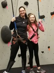 "Laicee Hatfield enjoys rock climbing with daughter Alyx, 10, at National Fitness Center Saturday, Nov. 17. ""Anytime we can get out of the house and do something fun and engaging we take advantage of that. We're not tied to the TV,"" said Hatfield."