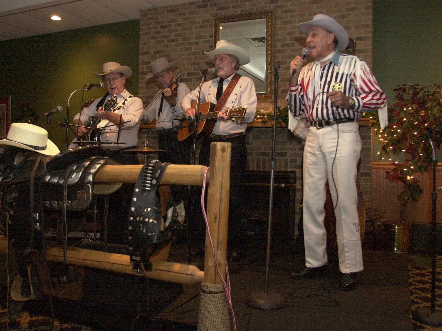 "0729andy.3.CC--zones-- ""Marshall Andy"" Smalls, who sings cowboy and Western songs,  performs with his band, Riders of the Silver Screen, on Sunday at the Bearden Banquet Hall. News-Sentinel staff photo by Cathy Clarke. ASA200 Image# DSC_0010.JPG"