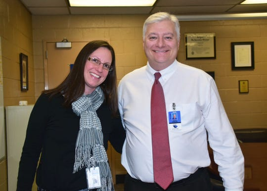 Laicee Hatfield with Karns High School Principal Brad Corum at the school Wednesday, Nov. 28.