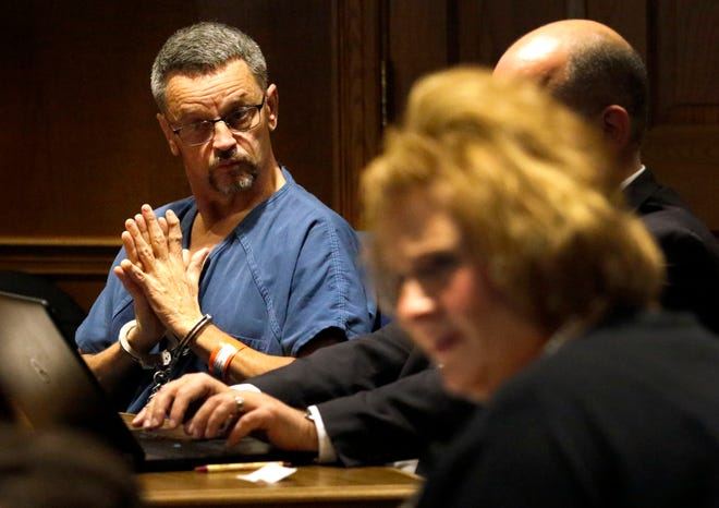 William Johnson sits next to his attorney Andrew Sanderson Friday, Nov. 30, 2018, in Fairfield County Common Pleas Court in Lancaster. Johnson was sentenced to 18 months in prison for crimes stemming from a bar fight earlier this year. He was also ordered to pay more than $28,000 to two Washington County banks as part of restitution from a 2002 robbery case.