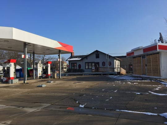 A former gas station at 401 E. Grand River Ave. in Howell, seen boarded up Friday, Nov. 30, 2018, has been the subject of dangerous building proceedings, but its owner says he's going to fix it up.
