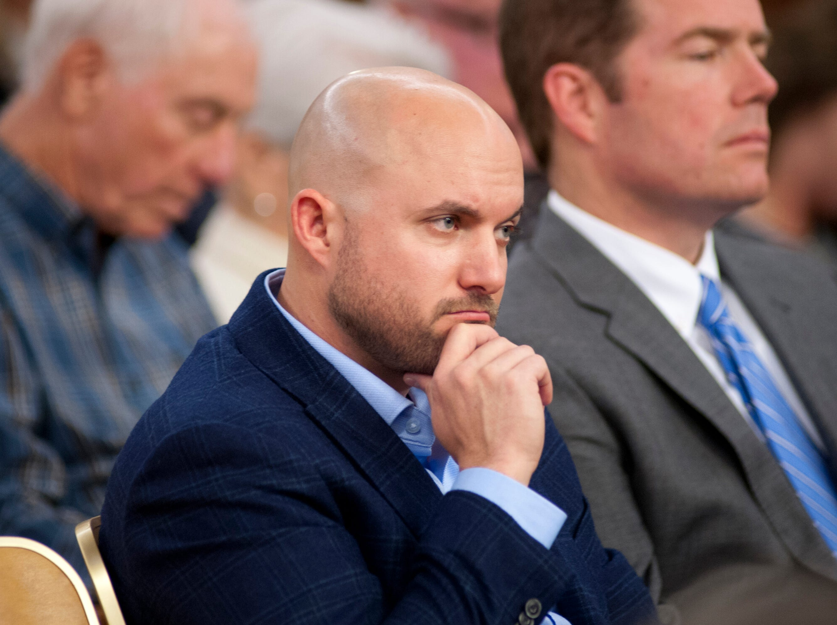 Tanner Micheli, director of real estate development at Topgolf, listens as the Louisville Metro Council debates approving planning commission recommendations on his company at the council's meeting on Nov. 29, 2018.