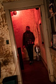 Will Russell poses in the doorway of a room in the Old Man Hammer's Haunted Scare BNB, at The Marvelous Mystery shop, in the Highlands. Nov. 29, 2018.