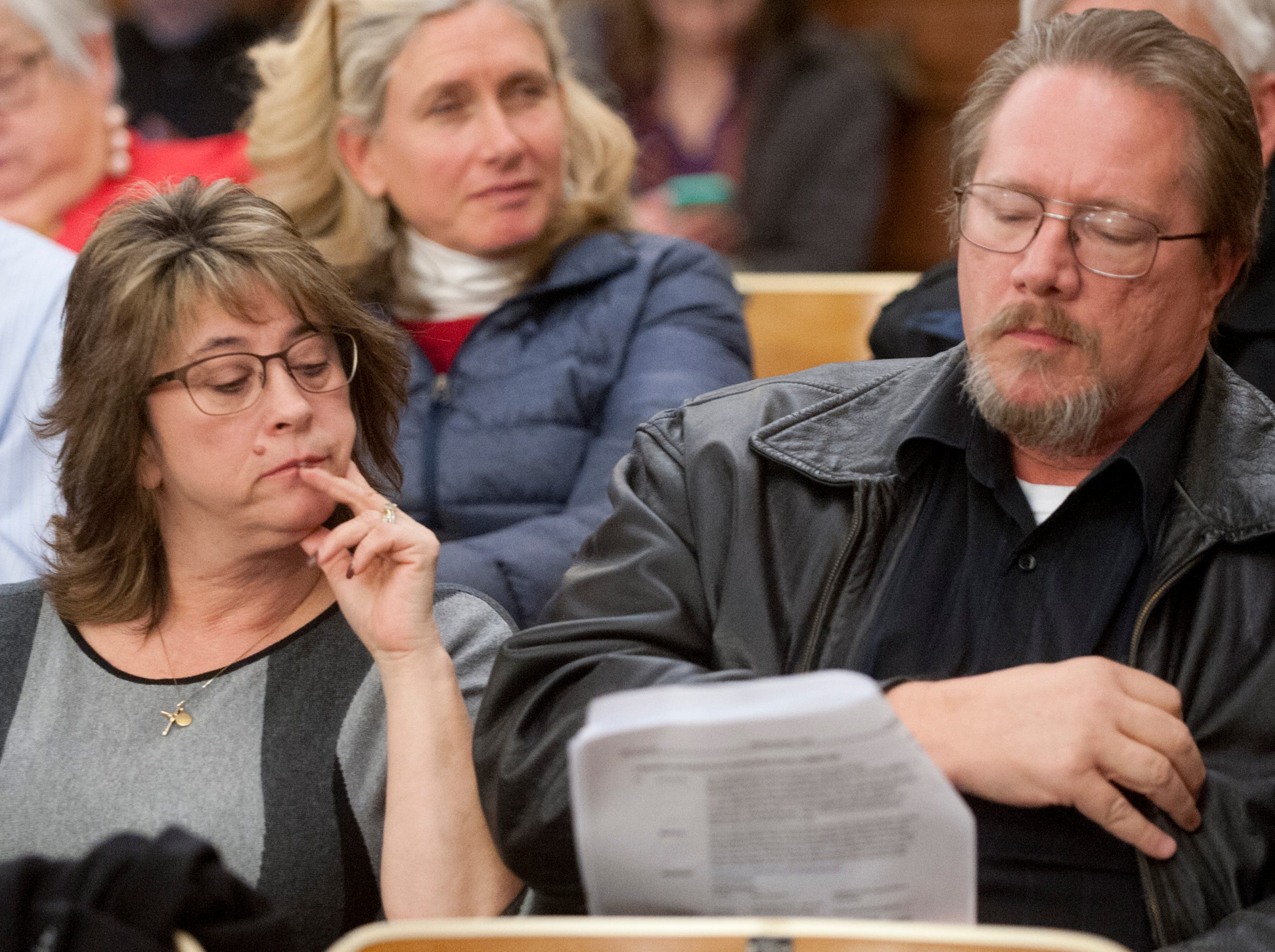 Hurstbourne homeowner Peggy Barber and her husband Bryan look over the Louisville Metro Council minutes prior to a council vote approving planning commission recommendations on Topgolf at the council's Nov. 29, 2018 meeting.