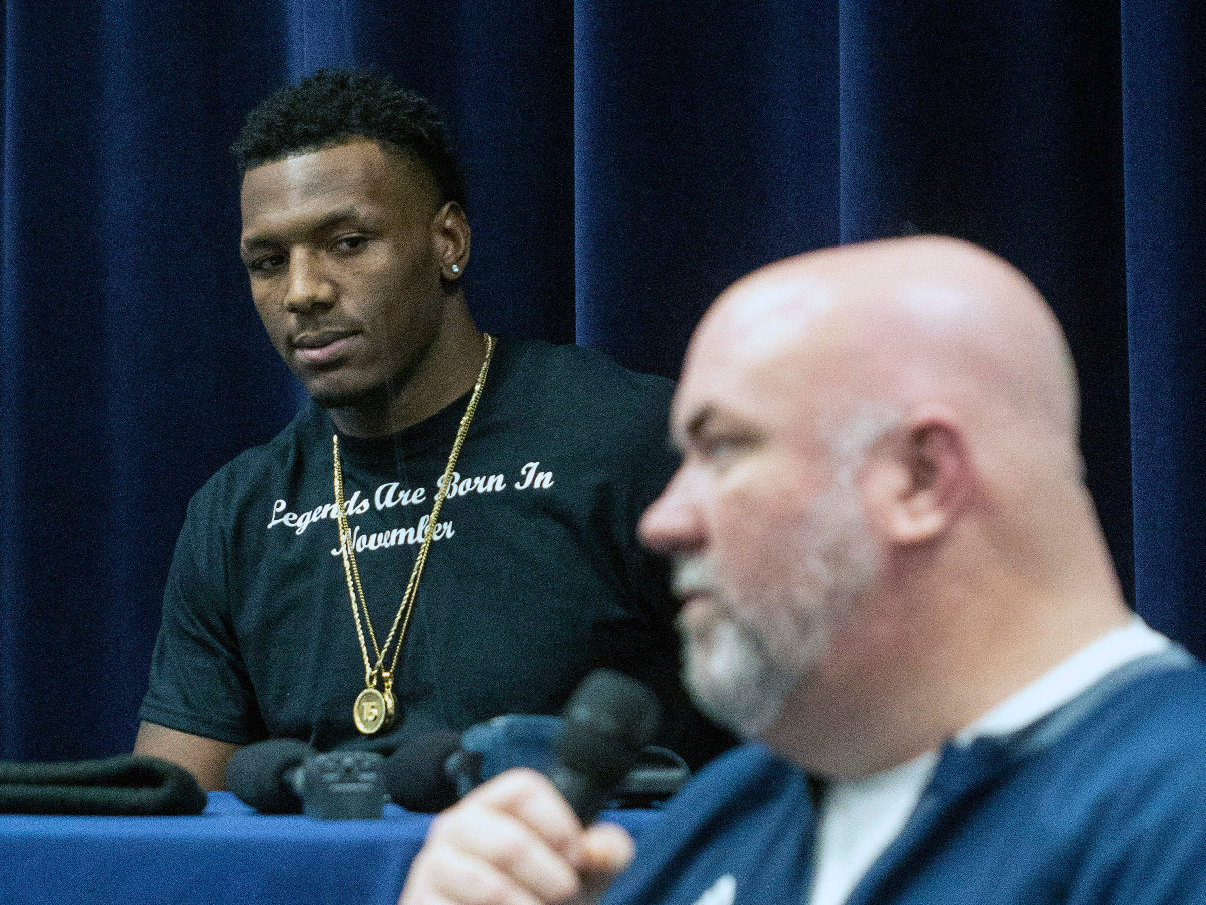 Moore High School defensive end JJ Weaver listened as his coach Rob Reader spoke about the relationship and success they built together. 11/30/18