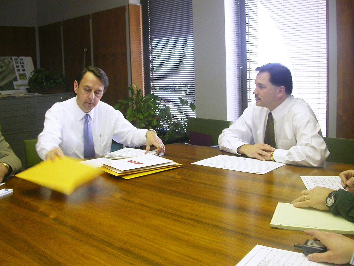 "-  -Text: Three photos are attached of the bid opening in Jeffersonville this afternoon for the Quartermaster Depot remodeling. In the photos with two people, Architect Wayne Estopinal is to the left, opening bids, next to Jeffersonville Mayor Rob Waiz on right. Ben Hershberg Photo Feb 15, 05-  -Caption: By Ben Zion Hershberg, The Courier-Journal; Architect Wayne Estopinal, left, said he must thoroughly review the six bids received. ""We are going to have to rethink,"" Mayor Rob Waiz said."