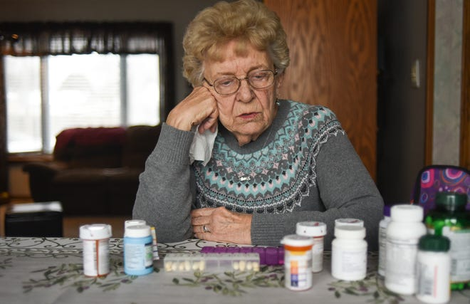 """My salary hasn't gone up since I've retired,"" Dorothy Tupper, 86, of Holt said, as she speaks about the increasing cost of her medications while having her portrait taken, Wednesday, Nov. 28, 2018.  Tupper has lived with her daughter Debi Lewis since her home in Texas was destroyed in hurricane Harvey.  She takes one blood thinner, and three medications for high blood pressure."