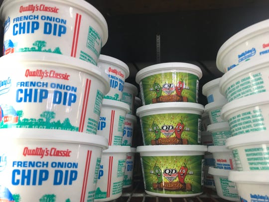 "Quality Dairy ""Fiesta Dip"" sits next to the company's French onion chip dip at a store in Lansing Friday."
