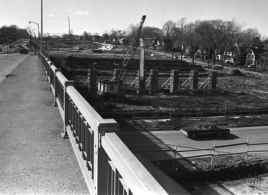Construction of the Cedar Street exit ramp for Interstate 496, shown on Dec. 28, 1967.