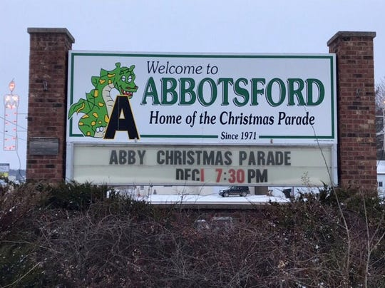 "The Welcome to Abbotsford sign on the east side of Abbotsford showing ""Puff"" on the sign."