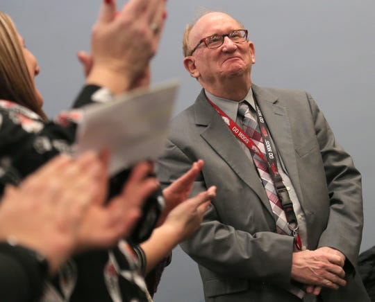 Retiring Richland County Magistrate Garry Dalbey receives an applause from people gathered for Judge Phil Naumoff's swearing-in ceremony on Friday.